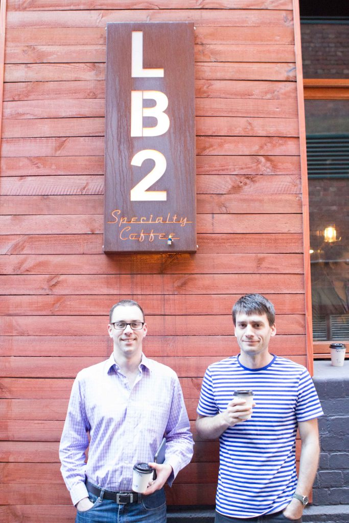 George & Sam enjoying one of the fashionable new Coffee joints. (Mini-T is holding onto the sign)